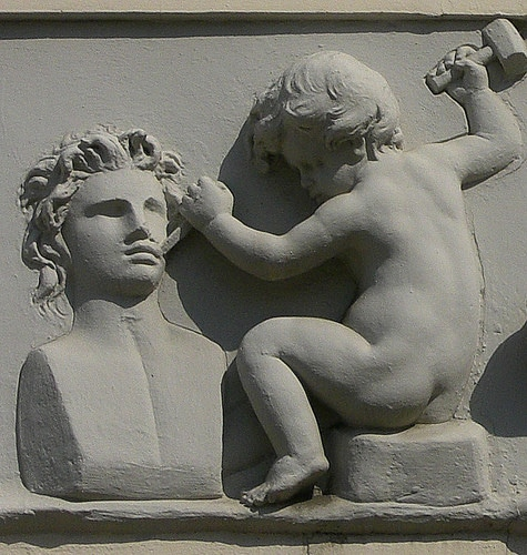 chiseling baby statue