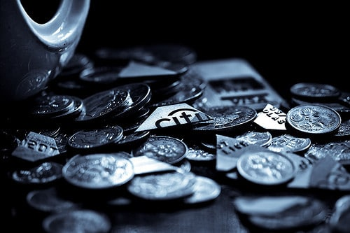 coins and chopped credit cards