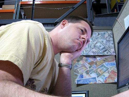 man bored at desk