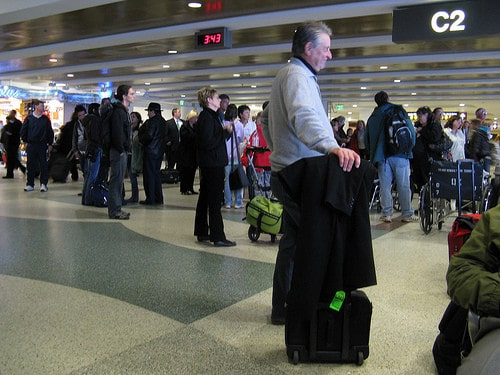 man waiting in line at airport