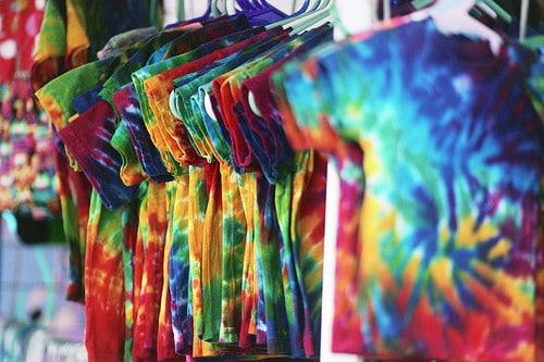 tie dye shirts on a rack