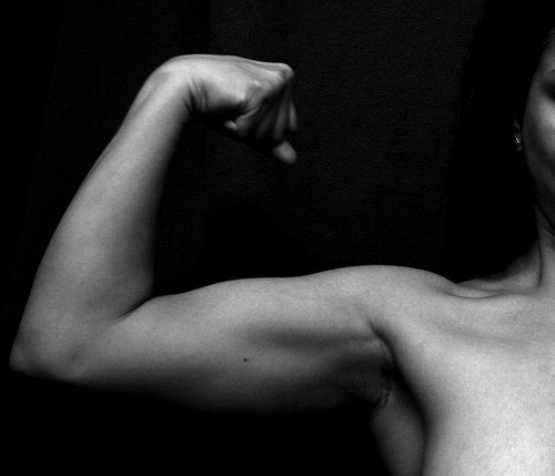 womans curled bicep