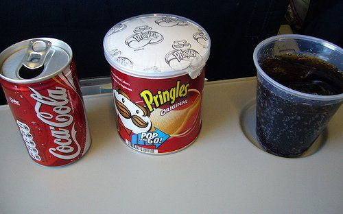 coke and pringles on a plane