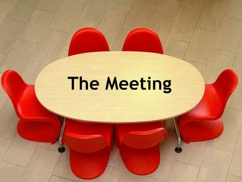 meeting table with red chairs