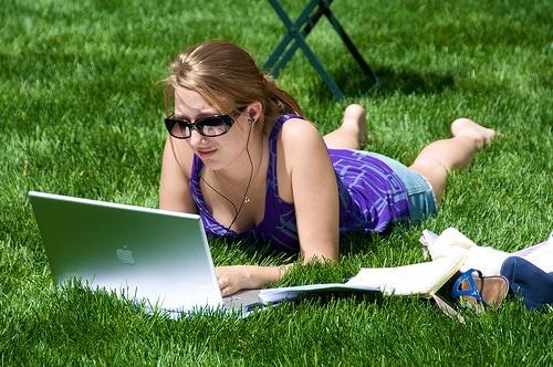 girl using laptop in park