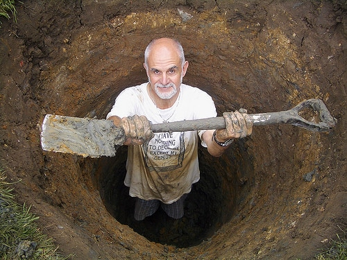 man digging hole