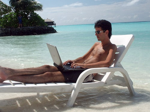 working on laptop at beach