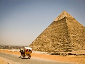 A Lonely Tout Looking For Business At The Great Pyramids Of Giza, Egypt
