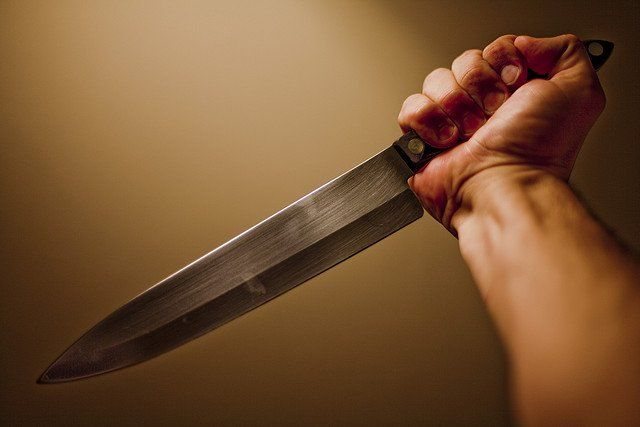 holding kitchen knife