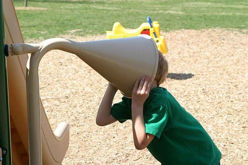 boy with head stuck in funnel
